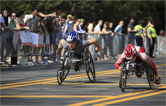 The lead women's wheelchair competitors raced close to each other in the Boston Marathon on April 16, 2012.