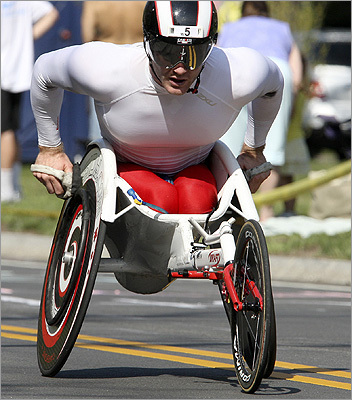 Wheelchair winner Joshua Cassidy of Toronto pushed through the dreaded hill of Newton's Heartbreak Hill.