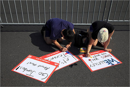 Supporters made signs for Boston Marathon runners on April 16, 2012.