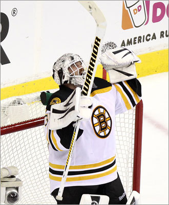 Bruins goalie Tim Thomas celebrated his team's victory in Game 3.
