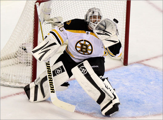 Tim Thomas made a glove save during the first period. Thomas saved 29 of the 32 shots he faced.