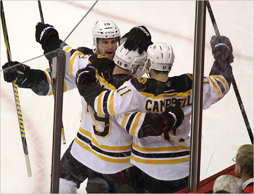 Bruins right wing Rich Peverley and teammates celebrated after tying the game at 1 during the first period.