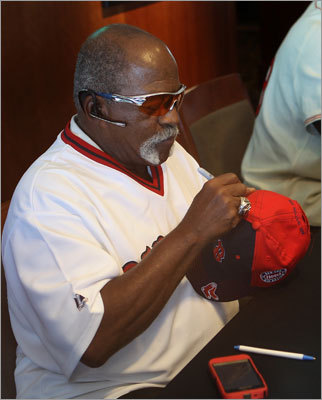 Former pitcher Luis Tiant signed a cap for a fan. Tiant played eight seasons for Boston from 1971 to 1978.