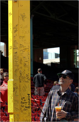 Brendan Mulkern, 72, of Needham has been coming to the park since 1949-50. He took a moment to look over the Johnny Pesky Pole in right field.