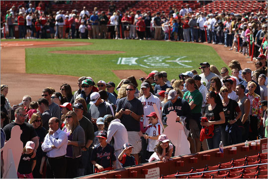 Thousands of Red Sox fans showed up Thursday for an open house at Fenway Park. The Red Sox invited fans to visit the park to see displays of historic artifacts and memorabilia, tour the ballpark and get autographs from former Red Sox players.