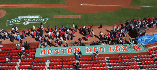 A line formed to enter the Red Sox dugout to see the field the way the players do during a game.