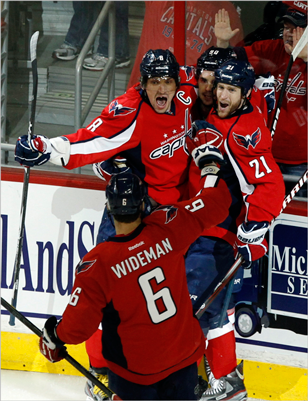 Capitals Alex Ovechkin (top L), Marcus Johansson (top C), Brooks Laich (top R) and Dennis Wideman celebrated after Johansson scored a goal