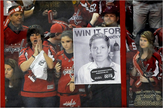 Fans held a sign for Nicklas Backstrom of the Capitals before Game 4. Backstrom was suspended one game for a cross-check in Game 3.