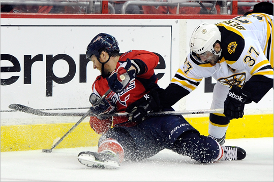 Dennis Wideman of the Capitals and Patrice Bergeron of the Bruins battled for the puck.