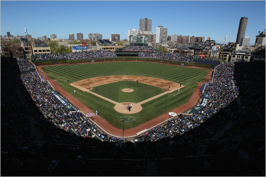 Wrigley Field Location: Chicago Opened: 1914 Capacity: 41,159 Famous for its ivy-covered brick outfield wall, the Cubs' stadium opened two years after Fenway Park. Although it has hosted several World Series, the Cubs have never won it all at Wrigley.