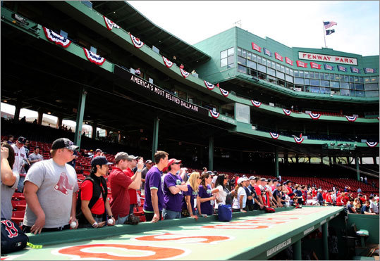 Fans came early to watch Red Sox batting practice.