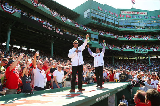 It's Fenway Park's birthday. Happy 100 years. Former Red Sox players Kevin Millar, left, and Pedro Martinez raise a toast with everyone in attendance to celebrate a century of Boston's beloved ballpark.
