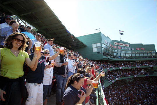 Fans joined in to toast Fenway Park before the game between the New York Yankees and the Red Sox to mark its 100th anniversary.