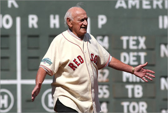 Former Red Sox player Frank Malzone (1955-65) made his way to third base. All of the former players gathered near their respective position during their playing days.