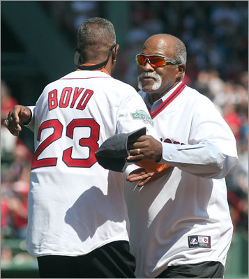 Former Red Sox players Luis Tiant (1971-78) and Dennis 'Oil can' Boyd (1982-89) hugged at the celebration.