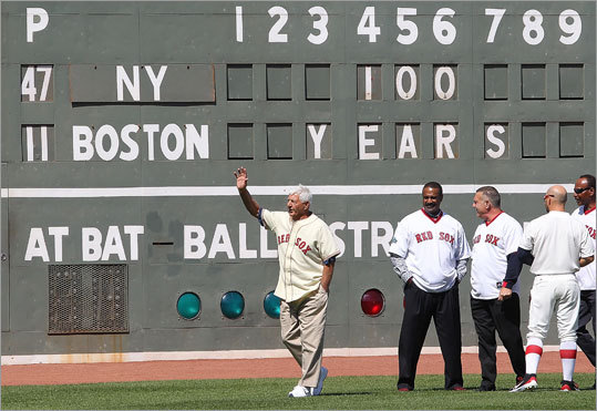 Carl Yastrzemski, left, and other former Red Sox players stood in left field during the celebration.