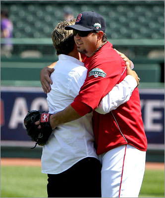 Former Red Sox player Kevin Millar hugged Josh Beckett before the game.