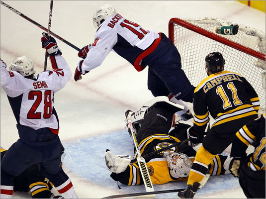 The Capitals' Alexander Semin, left, was jubilant after he scored in the second period past Bruins goalie Tim Thomas. The Capitals' Niicklas Backstrom fell over Thomas.