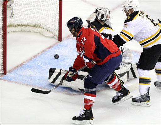 Washington Capitals right wing Mike Knuble (22) looked on as a goal from Capitals defenseman Mike Green got past Bruins goalie Tim Thomas in the first period. The goal tied the score at one.