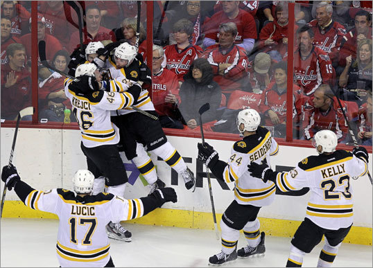 Bruins players celebrated Tyler Seguin's goal on the ice as dejected Capitals fans looked on.