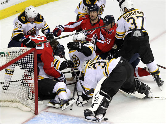 Players from both teams fought for positioning in front of Bruins goaltender Tim Thomas during the first period.