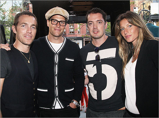 April 20 in Boston More than 200 guests attended the opening night party for women's and men's apparel store Rag and Bone on Newbury Street. Managing partners David Neville and Marcus Wainright with New England Patriots quarterback Tom Brady (second left) and his wife, model Gisele Bundchen (right).