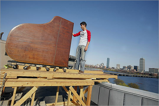 MIT student Aziz Albahar checked the baby grand piano that was dropped from the roof of a dormitory on April 24, 2008.
