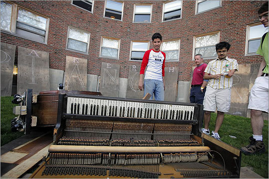 Students checked the piano's damage after its fall.