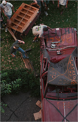 Students climbed over a piano that they dropped from the roof of Baker House onto a car on Nov. 5, 1994.