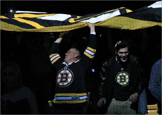 Fans continued the Bruins tradition of passing a large flag around the arena prior to the playoff game.