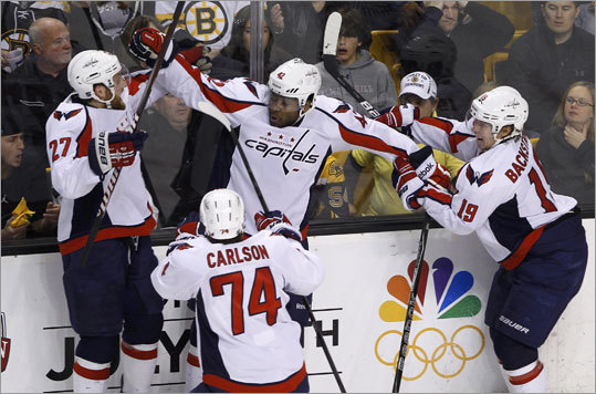 Joel Ward (center) made his first goal of the playoffs a memorable one. He backhanded a rebound into the net to give the Capitals the first-round playoff series.