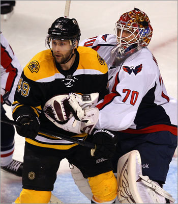 Bruins forward Rich Peverley and Capitals goalie Braden Holtby jockeyed for position in front of the net in the third period.