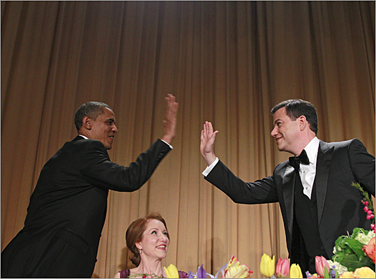 The president went in for a high-five with host Jimmy Kimmel at the event.