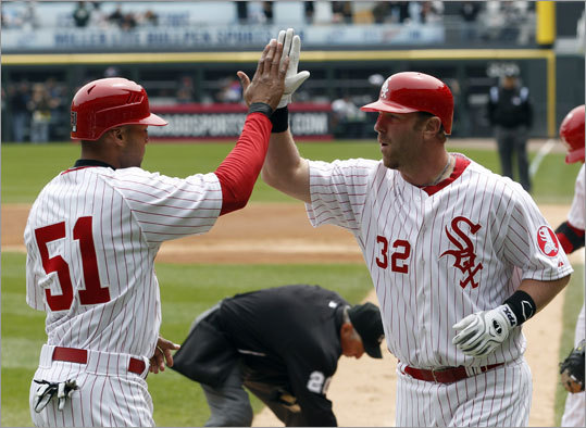 Chicago's Adam Dunn (right) hit a two-run home run in the first inning to put the White Sox up, 3-0.