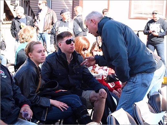 Coleman Nee, Massachusetts Secretary of Veterans' Services, spoke with wounded Marine Corporal Evan Reichenthal and his family at the event.