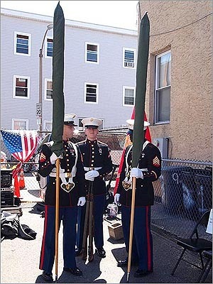 A color guard consisting of Corporal Eric Julin, Lance Corporal Connor Sutherland, and Sergeant Gregory Jean awaiting the beginning of Saturday's ceremony.