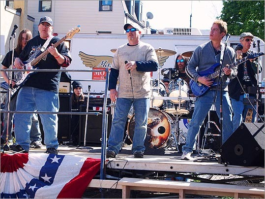 Local rock band Cambridge 213 played covers of classic rock songs at the barbecue.