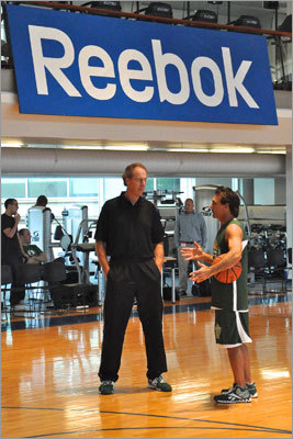 Celtics legend and basketball Hall of Famer Dave Cowens (left) hosted a celebrity basketball game on Tues., May 1 to promote his youth basketball camp. Sponsored by Reebok, the event was held at the company's headquarters in Canton and included athletes like former BC and Patriots quarterback Doug Flutie (right).