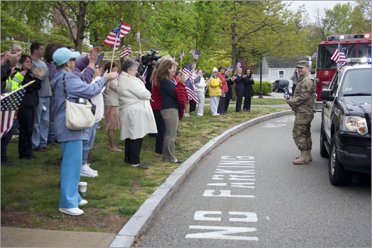 National Guard corporal and Purple Heart recipient John Marquardt was welcomed back to Hingham with fanfare on Wednesday, as residents and officials came out to offer commendations to the Hingham police officer. Read the full story. Marquardt is greeted with fanfare as he steps out of a police car that escorted him to the ceremony.