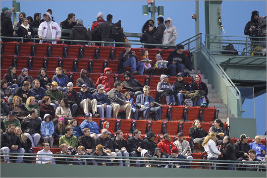 The Red Sox are closing in on the longest sellout streak in the history of US professional sports, 814 by the NBA's Portland Trailblazers from 1977 to 1995. They are on track to break Portland's record early next season. Pictured: Empty seats are seen at the top of the second inning.
