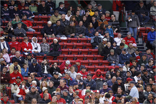 'I can understand the confusion,' said Sam Kennedy, the team's executive vice president. 'But we operate by a definition that is commonly practiced throughout Major League Baseball and professional sports.' Pictured: Empty seats in the bottom of the first inning.