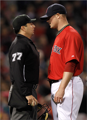 Jon Lester talked with umpire Jim Reynolds after the third inning. Lester allowed three earned runs in six innings, striking out two and walking three.