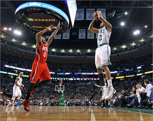 Avery Bradley took a three-pointer as the Hawks' Jeff Teague defended in the first half.