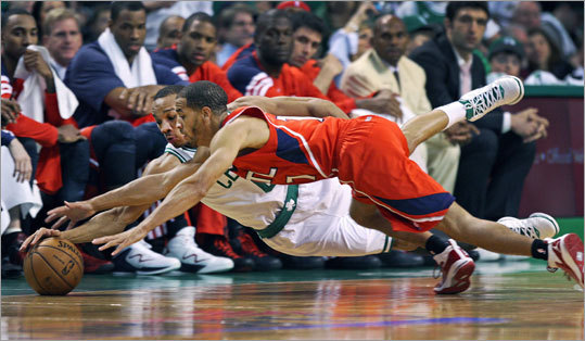 The Celtics' Avery Bradley and the Hawks' Jannero Pargo dove for a first-half loose ball in front of the Atlanta bench.