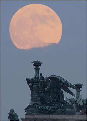The moon could be seen in the clouds behind the St. Isaak's Cathedral in St. Petersburg, Russia.