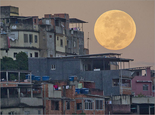 The supermoon set behind the Mare shanty town complex in Rio de Janeiro.