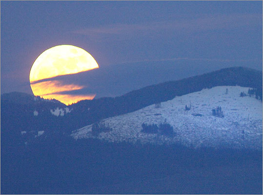 The supermoon rose over Cultus Mountain in this view from Skagit County, Wash.