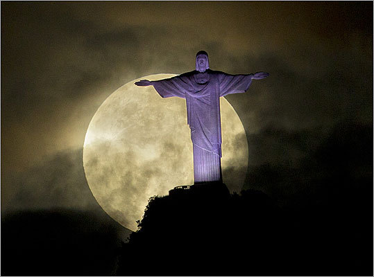 The big, bright moon was visible behind the Christ the Redeemer statue in Rio de Janeiro.