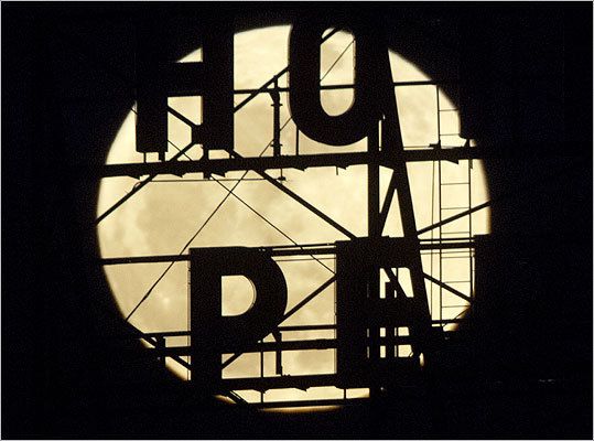 A sign on the temporarily closed Hotel Pere Marquette in Peoria, Illinois, was illuminated by the moon.