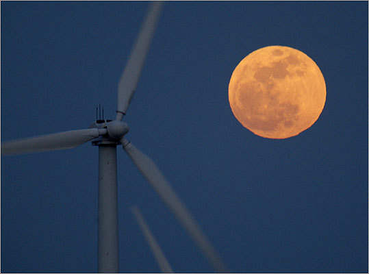 The supermoon rose behind wind turbines near Palm Springs, Calif.